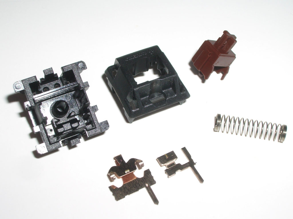 A disassembled Cherry MX Brown Switch